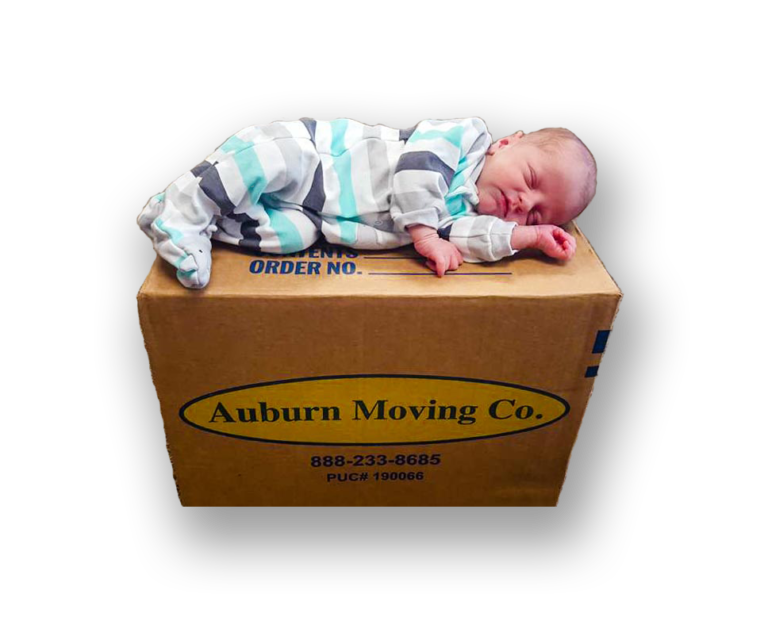 baby sleeping on roseville moving company box