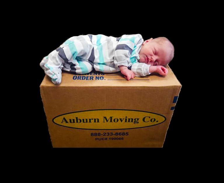 baby sleeping on roseville moving company box