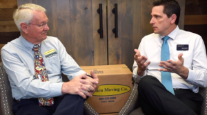 bruce cosgrove talks with real estate agent about moving companies